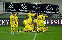 Phoenix players celebrate the second goal during the A-League football match between Wellington Phoenix and Western United FC at Sky Stadium in Wellington, New Zealand on Saturday, 22 May 2021. Photo: Dave Lintott / lintottphoto.co.nz