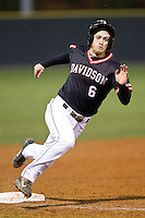 Ben Arkin (6) of the Davidson Wildcats slips as he rounds third base against the Wake Forest Demon Deacons at Wilson Field on March 19, 2014 in Davidson, North Carolina.  The Wildcats defeated the Demon Deacons 7-6.  (Brian Westerholt/Four Seam Images)