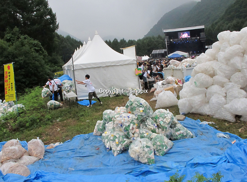 Recycling bottles, papers and plastic at the Fujirock Festival, Nigata, Japan. ..photo by Richard Jones/Sinopix.