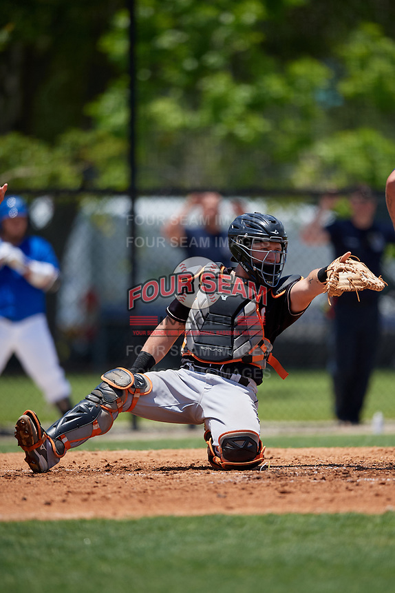 Jupiter Hammerheads catcher B.J. Lopez (18) points to the first base umpire for a check during a Florida State League game against the Dunedin Blue Jays on May 16, 2019 at Jack Russell Memorial Stadium in Clearwater, Florida.  Dunedin defeated Jupiter 1-0.  (Mike Janes/Four Seam Images)