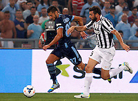 Calcio, Supercoppa di Lega: Juventus vs Lazio. Roma, stadio Olimpico, 18 agosto 2013<br /> Lazio midfielder Antonio Candreva is chased by Juventus defender Andrea Barzagli, right, during the Italian League Supercup football final match between Juventus and Lazio, at Rome's Olympic stadium,  18 August 2013.<br /> UPDATE IMAGES PRESS/Riccardo De Luca