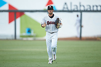 Birmingham Barons outfielder Blake Rutherford (9) jogs off the field between innings of the game against the Pensacola Blue Wahoos at Regions Field on July 7, 2019 in Birmingham, Alabama. The Barons defeated the Blue Wahoos 6-5 in 10 innings. (Brian Westerholt/Four Seam Images)