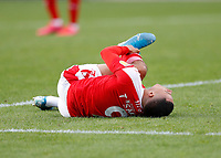 10th October 2020; The County Ground, Swindon, Wiltshire, England; English Football League One; Swindon Town versus AFC Wimbledon; Tyler Smith of Swindon Town lying on the pitch holding his ankle after being challenged in the penalty box by Daniel Csoka of AFC Wimbledon in the final moments of injury time in the 2nd half