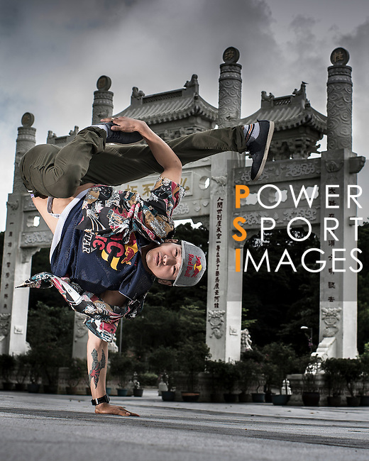 B-Boy Hong 10 of South Korea poses for a portrait at the Po Lin Buddhist monastery in the Hong Kong's Lantau island, ahead the Red Bull BC One Cypher on July 01, 2012. Photo by Victor Fraile / The Power of Sport Images