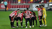 Brentford players keep their distance in the pre-match huddle during Brentford vs Luton Town, Sky Bet EFL Championship Football at the Brentford Community Stadium on 20th January 2021