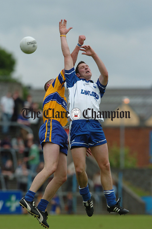 Waterford's Gary Hurney contests a high ball with Clare's David Russell in Ennis. Photograph By John Kelly.