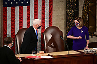 Speaker of the United States House of Representatives Nancy Pelosi (Democrat of California), right, greets U.S. Vice President Mike Pence while wearing protective masks during a joint session of Congress to count the Electoral College votes of the 2020 presidential election in the House Chamber in Washington, D.C., U.S., on Wednesday, Jan. 6, 2021. Congress is meeting to certify Joe Biden as the winner of the 2020 presidential election, with scores of Republican lawmakers preparing to challenge the tally in a number of states during what is normally a largely ceremonial event. <br /> Credit: Erin Scott / Pool via CNP/AdMedia