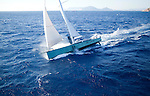 Nacira 67 designed by Axel de Beaufort ..The result is a wide planning hull shape equipped with a canting keel, twin rudder direction system and a 30 m high rotating mast.