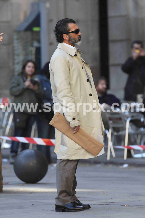 **ALL ROUND PICTURES FROM SOLARPIX.COM**.**WORLDWIDE SYNDICATION RIGHTS**NO PUBLICATION IN SPAIN**.shooting the latest Steven Sodergergh movie - Knock Out - in Barcelona, Spain. 23 February 2010..This pic: Antonio Banderas..JOB REF: 11075 MER       DATE: 23_02_2010.**MUST CREDIT SOLARPIX.COM OR DOUBLE FEE WILL BE CHARGED**.**MUST NOTIFY SOLARPIX OF ONLINE USAGE**.**CALL US ON: +34 952 811 768 or LOW RATE FROM UK 0844 617 7637**