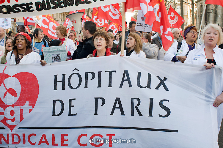Health workers march in Paris, joining up to 3 million people across France during a national strike against the Sarkozy government's economic policies.