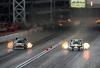 Nov. 1, 2008; Las Vegas, NV, USA: NHRA funny car driver Jerry Tolliver (left) races Tony Pedregon during qualifying for the Las Vegas Nationals at The Strip in Las Vegas. Mandatory Credit: Mark J. Rebilas-