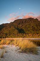 Sunset on beach with Kohaihai River and moon near Karamea, Kahurangi National Park, Buller Region, West Coast, New Zealand