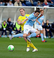 Philadelphia forward Amy Rodriguez (8) fouls Chicago midfielder Karen Carney (14).  The Philadelphia Independence defeated the Chicago Red Stars 1-0 at Toyota Park in Bridgeview, IL on May 15, 2010.