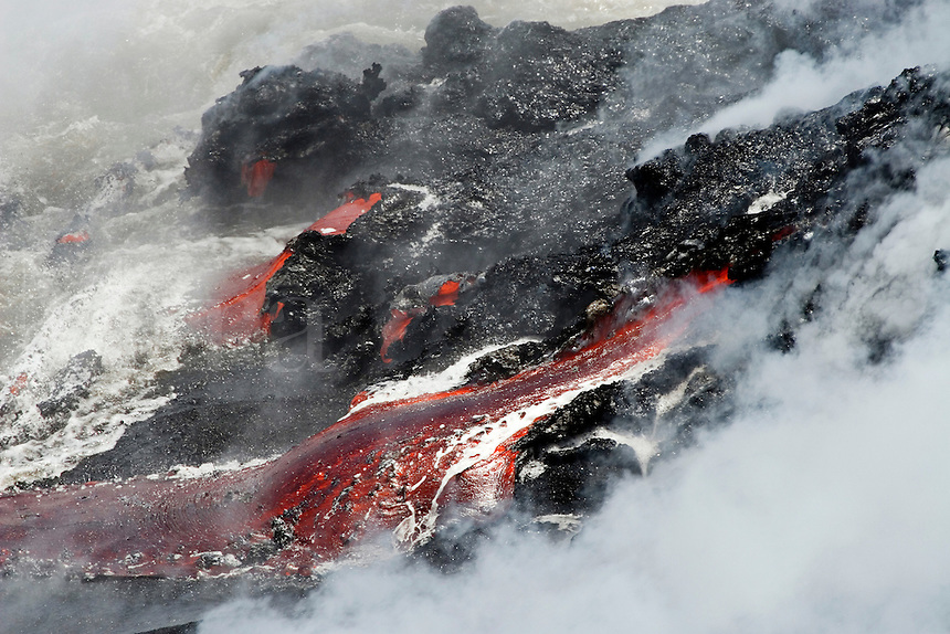 Steam and lava flow pouring into the Pacific Ocean, Volcanos National Park, Hawaii.<br />
