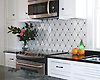 This custom kitchen features a handmade Quilt mosaic backsplash shown in Calacatta Tia, Nero Marquina, and Bardiglio from New Ravenna.<br /> <br /> For pricing samples and design help, click here: http://www.newravenna.com/showrooms/
