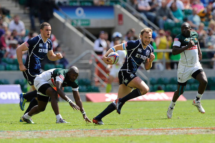 Byron McGuigan of Scotland in action against Zimbabwe during the iRB Marriott London Sevens at Twickenham on Sunday 13th May 2012 (Photo by Rob Munro)