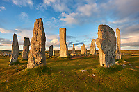 Calanais Standing Stones central stone circle erected between 2900-2600BC measuring 11 metres wide. At the centre of the ring stands a huge monolith stone 4.8 metres high weighing about 7 tonnes, which is perfectly orientated so that its widest sides face due north south. Calanais Neolithic Standing Stone (Tursachan Chalanais) , Isle of Lewis, Outer Hebrides, Scotland.