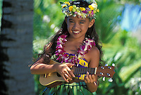 Beautiful Hawaiian girl (age 7) playing ukulele with orchid lei and haku lei on head