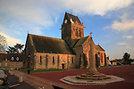 Church in the village of Sainte Mere Eglise with effigy of John Steele, his parachute having caught on a spire, Normandy, France.