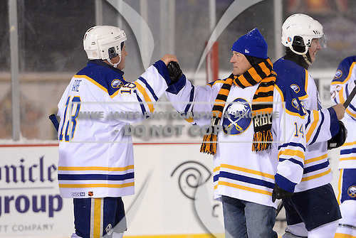 Honorary Coach Rene Robert (14) and Danny Gare (18) greet each other after The Frozen Frontier Buffalo Sabres vs. Rochester Amerks Alumni Game at Frontier Field on December 15, 2013 in Rochester, New York.  (Copyright Mike Janes Photography)