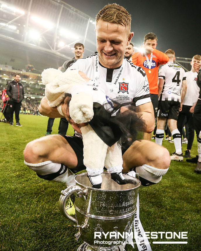Dane Massey with his daughter Georgia celebrates with the trophy at the end of the  Irish Daily Mail FAI Cup Final between Dundalk and Cork City, on Sunday 4th November 2018, at the Aviva Stadium, Dublin. Mandatory Credit: Michael P Ryan.