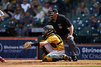 Missouri Tigers catcher Chad McDaniel (20) sets a target as home plate umpire Mark Hutchinson looks on during the game against the Oklahoma Sooners in game four of the 2020 Shriners Hospitals for Children College Classic at Minute Maid Park on February 29, 2020 in Houston, Texas. The Tigers defeated the Sooners 8-7. (Brian Westerholt/Four Seam Images)