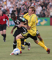 DC United midfielder Freddy Adu (9) fighting for control of the ball against Columbus Crew defender Chris Leitch (33) during the game. DC United defeated the Columbus Crew 3-2, Saturday, July 15, 2006.