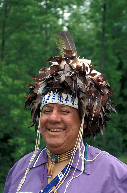 Iroquois man, Russell Smith, wearing a wampum beaded headband with a feathered traditional headdress called a gustoweh
