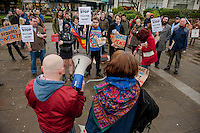 Saturday 05 April 2014<br /> Pictured: Anti Fascist campaigners in Castle Square, Swansea<br /> Re: White Pride and Anti Fascist groups protest in Swansea City Cebtre