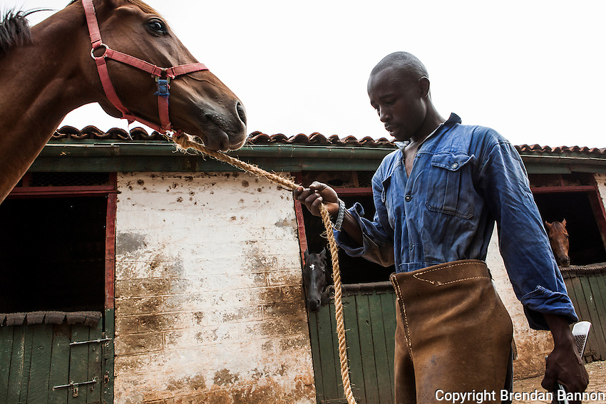Farrier George Njuguna after shoeing a horse at Ngong Racecourse. Njuguna has worked for various trainers  at Ngong Racecourse since 1999 when he began as a syce with trainer Julie McCann. He now works freelance at Ngong Racecourse. Nairobi, Kenya. March 22, 2013. Photo: Brendan Bannon