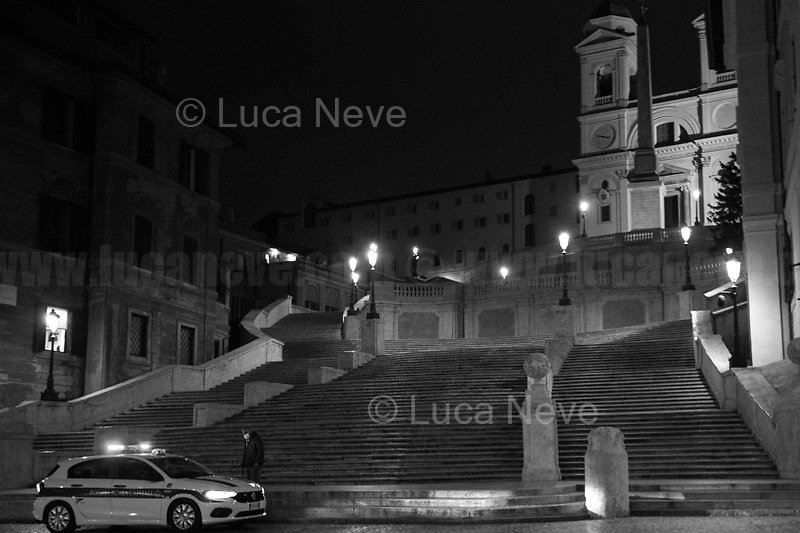 """Piazza di Spagna (Spanish Steps).<br /> <br /> Rome, 23/10/2020. Documenting the """"curfew"""" (coprifuoco) imposed from Friday night in Rome and its surrounding Lazio Region. The local authorities tightened rules and restrictions due to a spike in the Covid-19 / Coronavirus cases. 23 October bulletins sees 19.143 new cases, 91 people died, 182.032 tests made. Today, the President of Lazio Region, Nicola Zingaretti (Leader of the Democratic Party, PD, party member of the Italian Coalition Government), imposed the night curfew, from midnight to 5AM, for 30 days (1.). A new self-certification (autocertificazione, downloadable from here 1.) is needed to leave home which is allowed only for urgent reasons, mainly work and health. Furthermore, the Mayor of Rome, Virginia Raggi, implemented """"no-go zones"""" restrictions from 9PM in some of the areas and squares of the Eternal City famous for the nightlife, including Campo de' Fiori, Via del Pigneto, Piazza Trilussa in Trastevere district and Piazza Madonna de' Monti.<br /> <br /> Footnotes & Links:<br /> 1. http://www.regione.lazio.it/binary/rl_main/tbl_news/ordinanza_regione_lazio_intesa_Ministro_salute__mod_accettate_rev1__ore_24_1_signed.pdf<br /> <br /> March 2020, Coronavirus lockdown in Rome:<br /> - 12.03.2020 - Rome's Lockdown for the Outbreak of the Coronavirus In Italy - SARS-CoV-2 - COVID-19: https://lucaneve.photoshelter.com/gallery/12-03-2020-Romes-Lockdown-for-the-Outbreak-of-the-Coronavirus-In-Italy-SARS-CoV-2-COVID-19/G0000jGtenBegsts/<br /> - 07-23.03.2020 - Villaggio Olimpico Ai Tempi del COVID-19 - Rome's Olympic Village Under Lockdown: https://lucaneve.photoshelter.com/gallery/07-23-03-2020-Villaggio-Olimpico-Ai-Tempi-del-COVID-19-Romes-Olympic-Village-Under-Lockdown/G0000D2L9l0ibXZI/"""