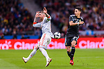 Eduardo Meza of Argentina (R) runs with the ball while been defended by Sergio Ramos of Spain (L) during the International Friendly 2018 match between Spain and Argentina at Wanda Metropolitano Stadium on 27 March 2018 in Madrid, Spain. Photo by Diego Souto / Power Sport Images