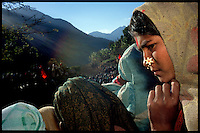 A village girl watches a celebration to mark the 9th anniversary of the start of the Maoist revolution in the village of Pipal, Nepal on Saturday, 12 February 2005.<br />