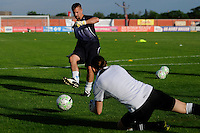 Sky Blue FC assistant coach Rick Stainton warms up goalkeeper Jenni Branam (23). Sky Blue FC defeated the Atlanta Beat 3-0 during a Women's Professional Soccer (WPS) match at Yurcak Field in Piscataway, NJ, on May 21, 2011.