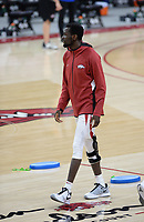 Arkansas forward Abayomi Iyiola warms up Tuesday, Feb. 16, 2021, before the start of the first half of play against Florida in Bud Walton Arena. Visit nwaonline.com/210217Daily/ for today's photo gallery. <br /> (NWA Democrat-Gazette/Andy Shupe)
