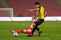 Josh Knight (on loan from Leicester City) of Wycombe Wanderers and Adam Masina of Watford during the Sky Bet Championship behind closed doors match between Watford and Wycombe Wanderers at Vicarage Road, Watford, England on 3 March 2021. Photo by David Horn.