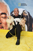 """LOS ANGELES - JULY 30:  Cesar Millan attends the premiere event for National Geographic's """"Cesar Millan: Better Human, Better Dog"""" at the Westfield Century City Mall Atrium on July 30, 2021 in Los Angeles, California. (Photo by Stewart Cook/National Geographic/PictureGroup)"""