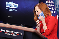 White House Press Secretary Jen Psaki takes of her mask during a press briefing in the Brady Press Briefing Room of the White House on Wednesday, February 17, 2021, in Washington, DC. <br /> CAP/MPI/RS<br /> ©RS/MPI/Capital Pictures
