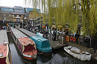 A busy scene at Camden Lock as people queue to buy takeaway food and drinks as the COVID-19 lockdown restrictions start to ease across the UK on 2nd April 2021