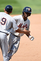 Binghamton Mets second baseman Dilson Herrera (20) is congratulated by coach Luis Rivera (9) after hitting a home run during a game against the Erie Seawolves on July 13, 2014 at Jerry Uht Park in Erie, Pennsylvania.  Binghamton defeated Erie 5-4.  (Mike Janes/Four Seam Images)
