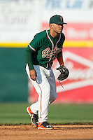 Greensboro Grasshoppers shortstop Justin Twine (1) on defense against the Hickory Crawdads at L.P. Frans Stadium on May 6, 2015 in Hickory, North Carolina.  The Crawdads defeated the Grasshoppers 1-0.  (Brian Westerholt/Four Seam Images)