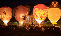 BNPS.co.uk (01202) 558833. <br /> Pic: CorinMesser/BNPS<br /> <br /> More than 30 hot air balloons put on a vibrant display of colour for Britain's first ever drive-in night glow event.<br /> <br /> This year's annual Sky Safari at Longleat Safari Park in Wiltshire had to have the socially-distanced audience viewing from the comfort of their cars.<br /> <br /> Some 400 vehicles parked up in front of the magnificent Longleat House at dusk yesterday (Fri) as the balloons fired up to light up the night sky.<br /> <br /> The balloons were in a series of unusual shapes and sizes including a lion, a koala, a wolf and even a guinea pig to reflect some of the animals kept at Longleat.