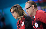 Sochi, RUSSIA - Mar 10 2014 -  Sonja Gaudet and Dennis Thiessen during Canada vs Norway in Wheelchair Curling round robin play at the 2014 Paralympic Winter Games in Sochi, Russia.  (Photo: Matthew Murnaghan/Canadian Paralympic Committee)