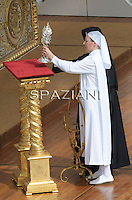 "Sister Marie Simon Pierre (L), with the relic containing blood of late Pope John Paul II, and Sister Tobiana (C) greet Pope Benedict XVI (R) during the beatification ceremony in Vatican City 01 May 2011. Pope Benedict XVI beatified his predecessor, the late John Paul II by proclaiming him ""Blessed"" in a ceremony in Rome's St Peter's Square attended by more than 1 million people."