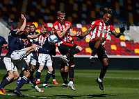 17th April 2021; Brentford Community Stadium, London, England; English Football League Championship Football, Brentford FC versus Millwall; Ivan Toney of Brentford taking a shot from a corner kick cross