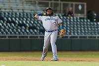 Surprise Saguaros third baseman Vladimir Guerrero Jr. (27), of the Toronto Blue Jays organization, throws to first base during an Arizona Fall League game against the Scottsdale Scorpions at Scottsdale Stadium on October 15, 2018 in Scottsdale, Arizona. Surprise defeated Scottsdale 2-0. (Zachary Lucy/Four Seam Images)
