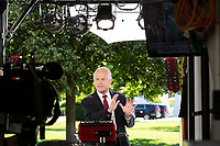 Peter Navarro, Director of Trade and Industrial Policy and Director of the White House National Trade Council speaks during a television interview at the White House in Washington D.C., U.S., on Monday, June 8, 2020.  Credit: Stefani Reynolds / CNP/AdMedia
