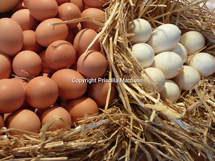 Closeup of brown and white eggs in a basket