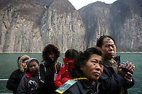 CHINA. Chongqing Province.  Tourists on a boat viewing the 3 Gorges.The flooding of the three Gorges, by damming the Yangtze near the town of YiChang, has remained a controversial subject due to the negative environmental consequences and the displacement of millions of people in the flood plain. The Yangtze River however is reported to be at its lowest level in 150 years as a result of a country-wide drought. It is China's longest river and the third longest in the world. Originating in Tibet, the river flows for 3,964 miles (6,380km) through central China into the East China Sea at Shanghai.  2008.