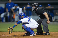 Burlington Royals catcher Xavier Fernandez (34) reaches for a pitch as home plate umpire Ryan Barneycastle looks on during the game against the Bluefield Blue Jays at Burlington Athletic Park on July 1, 2015 in Burlington, North Carolina.  The Royals defeated the Blue Jays 5-4. (Brian Westerholt/Four Seam Images)